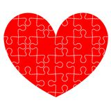 Jigsaw puzzle in the  red heart. Vector Stock Photos