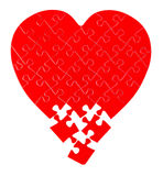 Jigsaw puzzle in a shape of a heart Royalty Free Stock Photos