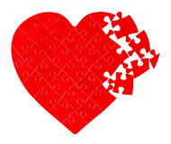 Jigsaw puzzle in a shape of a heart Stock Photos