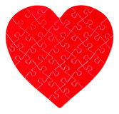 Jigsaw puzzle in a shape of a heart Stock Photography