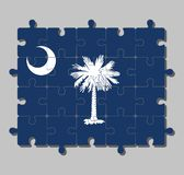 Jigsaw puzzle of South Carolina flag in white palmetto tree on an indigo field.