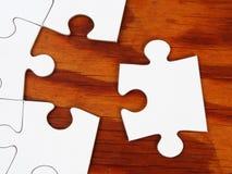 Jigsaw puzzle on a table Stock Photos