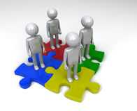 Jigsaw Puzzle Team. 4 figures of people on 4 connected pieces of a completed jigsaw puzzle Stock Photos