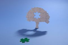 Jigsaw puzzle tree with green missing piece. Cut out jigsaw puzzle tree with green missing piece Stock Images