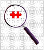 Odd Piece Magnifying Glass. A jigsaw puzzle under the magnifying glass Royalty Free Stock Image