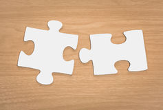 Jigsaw puzzle on wood Stock Photography