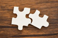 Jigsaw puzzle on wooden background top view stock image