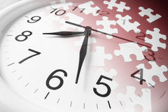 Jigsaw Puzzles and Clock Royalty Free Stock Images