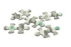 Jigsaw puzzles and US dollar note Royalty Free Stock Photo