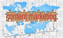 Jigsaw reveal content marketing word on cork background Royalty Free Stock Photos