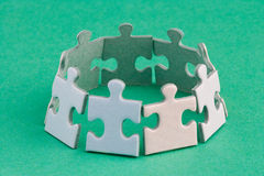 Jigsaw ring. A group of small upright jigsaw puzzle pieces Stock Photos