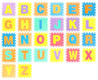 Jigsaw set with alphabet Stock Photography