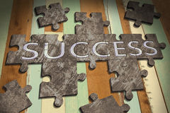 Jigsaw success. Success concept with  jigsaw puzzle on wooden table background,business concept Stock Photography