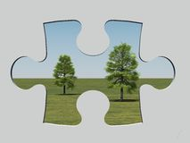 Jigsaw window. 3d render of two trees behind a jigsaw shaped hole Royalty Free Stock Photo