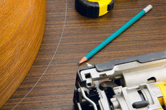 Jigsaw and wood. Workplace carpenter and his TOOLS stock image