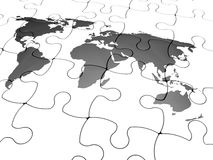Jigsaw of the world. 3D render of a jigsaw puzzle with the world map Royalty Free Stock Images