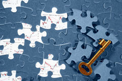 Jigzaw puzzle and economic graph Stock Photo