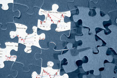 Jigzaw puzzle and economic graph Stock Image