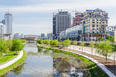 Jilin, China - circa July 2012: Songhua river and high rise residential buildings in Jilin, China royalty free stock images