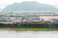 JILIN, CHINA - Jul 26 2015: Hyesan city of North Korea view from Changbai Town of China. The town of Changbai is a major border cr. Ossing between China and stock photography