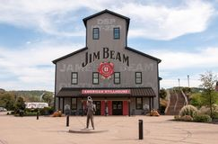 Jim Beam Stillhouse. The Jim Beam stillhouse visitor center with a statue of Jim Beam in front in Clermont, Kentucky Stock Photo
