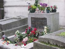 Jim Morisson`s grave stone monument in the Père Lachaise Cemetery, Paris stock images