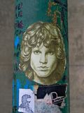 Jim Morrison Graffiti Face. Pole near Jim Morrison grave in Pere-Lachaise cemetery, Paris has a graffiti image of Morrison face. Each year thousands fans and royalty free stock images