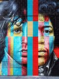 Jim Morrison och Jimi Hendrix grafitti på väggen i New York City arkivbild