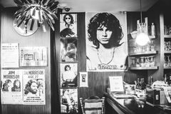 Jim Morrison photos in cafe Royalty Free Stock Photos