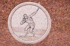 Jim Thorpe Grave Engavings Shot Put. JIM THORPE, PENNSYLVANIA, - SEPTEMBER 28: The Jim Thorpe shot put engraving on his grave memorial on September 28 2016 in Royalty Free Stock Photography