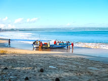 Jimbaran, Bali, Indonesia - April 20, 2012: The loacal fishermen with fish boat Royalty Free Stock Photography