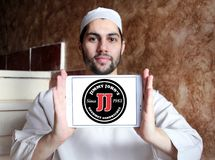 Jimmy John`s sandwich restaurant logo. Logo of Jimmy John`s restaurant on samsung tablet holded by arab muslim man. Jimmy John`s Franchise, LLC is a franchised royalty free stock photography