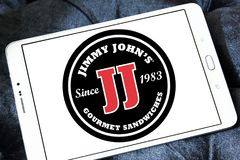 Jimmy John`s sandwich restaurant logo. Logo of Jimmy John`s restaurant on samsung tablet. Jimmy John`s Franchise, LLC is a franchised sandwich restaurant chain stock images