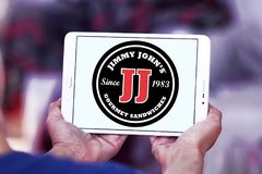 Jimmy John`s sandwich restaurant logo. Logo of Jimmy John`s restaurant on samsung tablet. Jimmy John`s Franchise, LLC is a franchised sandwich restaurant chain stock image