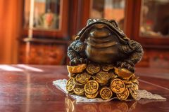 Jin Chan or money toad souvenir. Close up figure of three-legged money frog royalty free stock photos
