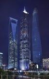 Jin Mao, Shanghai Tower and Shanghai World Financial Center at night. SHANGHAI-JUNE 4, 2014. Jin Mao, Shanghai Tower and Shanghai World Financial Center at stock photos