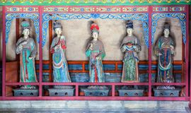 Jinci Memorial Temple(museum) scene. Maidservants coloured clay sculpture at the Saintly Mother hall Stock Photos