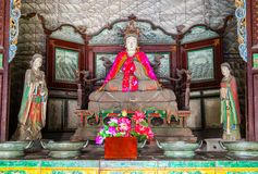 Jinci Memorial Temple(museum) scene. Saintly Mother and maidservants coloured clay sculpture at the Saintly Mother hall. Jinci is a famous old garden of China Stock Photography