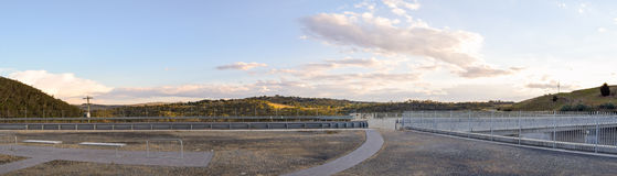 The Jindabyne Dam wall viewing area with mountain background. The Jindabyne Dam wall viewing area with mountain view background and cloudscape.  Lake Jindabyne Stock Image