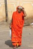 JIndian woman with an orange vivid veil Stock Photo