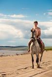 Jinete en la playa Imagen de archivo