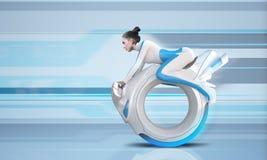 Jinete futuro atractivo de la bici Foto de archivo libre de regalías