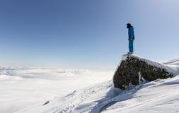 Jinete libre en el top de la montaña Imagenes de archivo