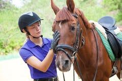Jinete y caballo de la mujer Imagenes de archivo