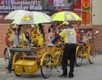 Jinetes de Trishaw, Malaca Foto de archivo libre de regalías