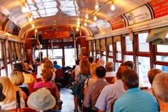 Jinetes históricos del coche de la calle de New Orleans Imagen de archivo libre de regalías