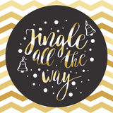 Jingle all the way. Christmas calligraphy quote for greeting cards, posters, banners. Christmas text and gold bells on gold zig zag pattern Royalty Free Stock Image