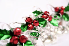 Jingle bell berries and Holly in a row Stock Photography