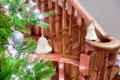 A jingle-bell on a Christmas tree Stock Images