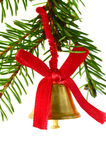Jingle bell on fir branch Royalty Free Stock Image